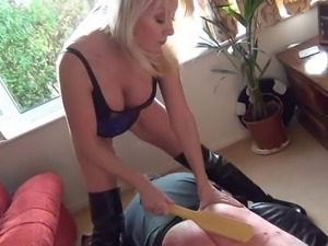 sexy mature mistress punishing slave in the living room