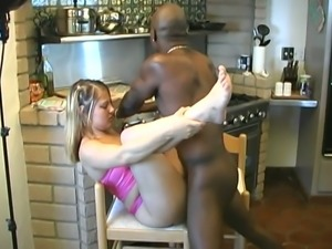 Svelte coed gets dominated by a big black cock in the kitchen