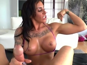 Hard body Austin Lynn with fake tits shows off her her pierced nipples as she...