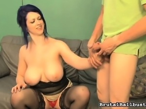 Voluptuous brunette in black stockings indulges in extreme ballbusting