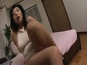 Big breasted Japanese hottie with sexy legs exposes her sub