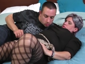 Granny with grey hair gets her pussy fucked by a younger guy
