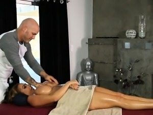 Big boobs woman screwed by her masseur on massage table