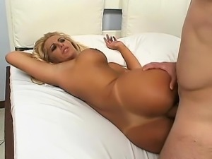 Busty blonde MILF gives him head and gets both holes hammered