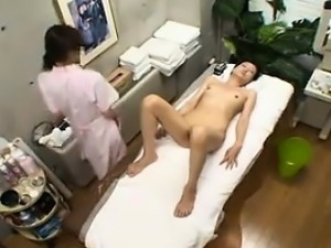 Classy Japanese lady gets her hairy pussy fingered on the m