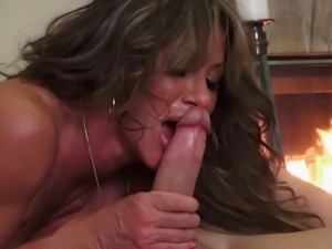 Ravishing MILF allows the guy to penetrate her next to the fireplace