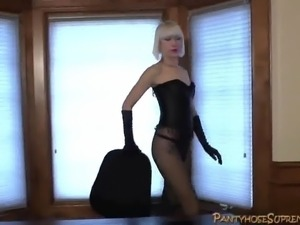 Femdom Mistress kicks and teases with lots of high heels