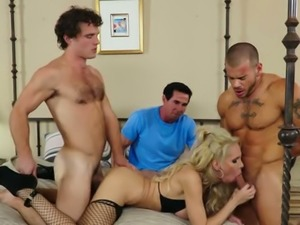 Mature blond haired filth Nadia North fucks with two young studs in front her...