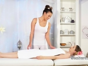 Two busty lesbians have massage sex
