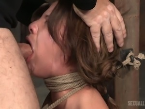 Cute white chick bound to the post and rammed hard in the mouth