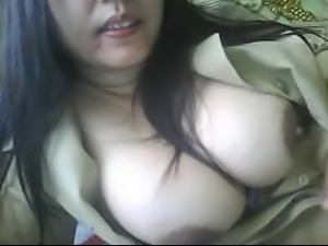 indonesian milf playing with her boobs