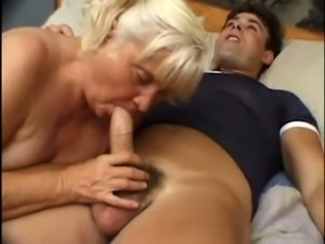 Fat mature blonde woman was happy to suck dick of a young man