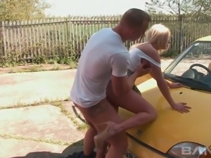 Stunning blond haired slut Sienna Day sucks her buddy off by his yellow car...