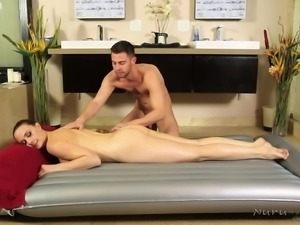 horny masseur pleasuring a brunette milf