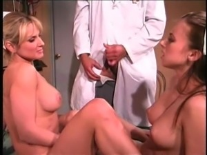 Doctor enjoys watching a couple of hot nurses play with a dildo
