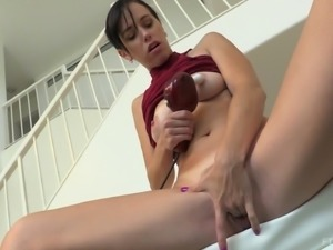 Putting a toy between her legs thinking about cumming hard