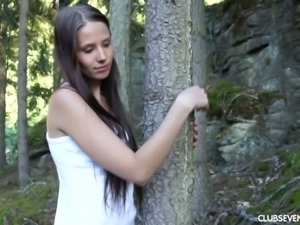 Country girl Vanessa O fingering her pussy in the middle of the forest