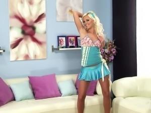 Beautiful blonde girl having great fun on a sofa