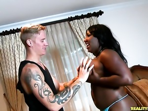 Tattooed ebony Luxury Amore with huge knockers and bald bush is good on her...