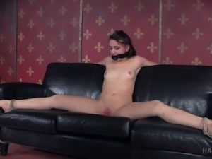 Sweet and cute brunette girl on the couch gagged and stretched
