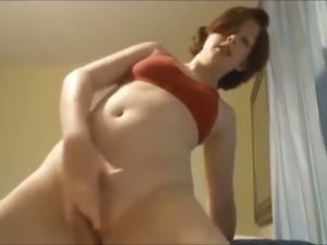 Cute and charming girlfriend fingering herself passionately