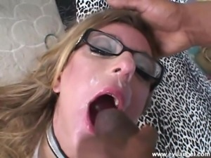 Dashing babe in glasses getting her face gang banged hard in a interracial shoot