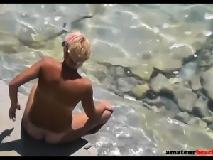 Horny nude wife masturbating and fucking on beach