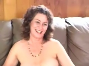Solo action of a mature white lady on the couch with a red sex toy