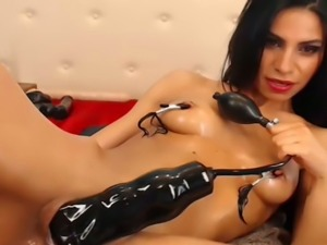 Spicy hot cam slut with nipple clamps DPs herself with her sex toys
