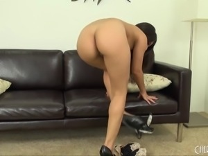 Stripping Latina fondles her titties and toys her pussy