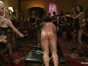 A few dominant chicks enjoy torturing a sexy stud indoors