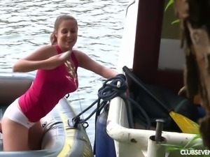 Fine young redhead in the small boat undresses and masturbates