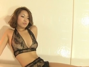 Charming Asian nympho Urara Inoue shows off her well-formed bum