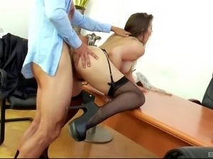 Dani Daniels spreading on a desk to have her beaver devoured