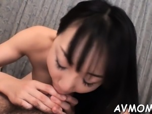 Pretty oriental gorgeous hottie licking knob