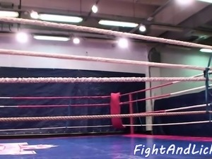 Stunning lesbians wrestling in a boxing ring