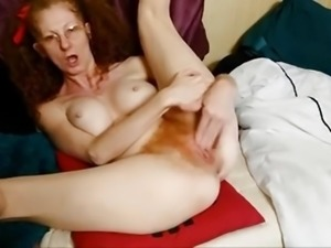 Milf fingers her red hairy pussy