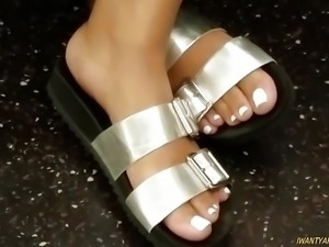 Candid ebony feet white toes