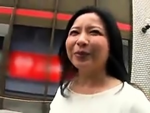 Buxom Japanese mom gets picked up and fucked by a young stud