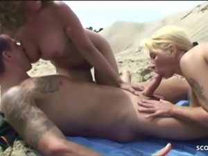 German Big Brother Klaus with two MILF in 3some at Beach