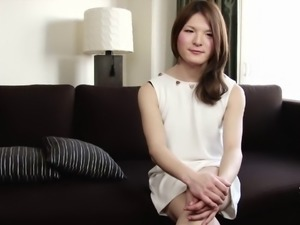 Sweet Japanese tranny babe strips and plays with her cock