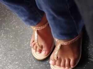 Candid cute mexican girl feet on the bus
