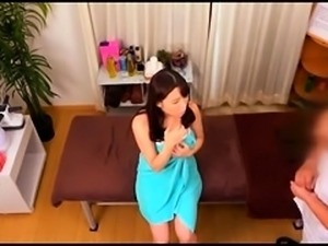 Buxom Japanese mom takes a deep banging on the massage bed