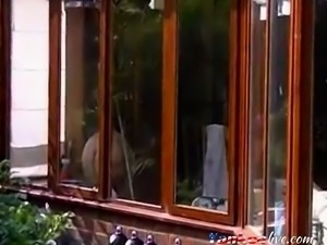 Neighbour cleaning windows.