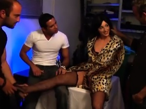 Attractive brunette milf has three guys drilling her holes