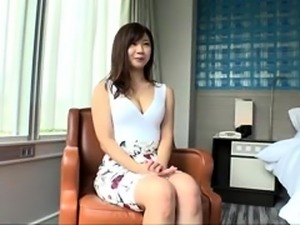 Enticing Japanese milf stuffs her hungry cunt with hard meat