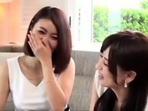 Two stunning Japanese babes take turns enjoying a hard cock